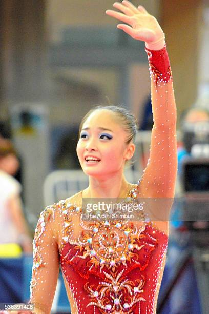 Kaho Minagawa of Japan waves to supporters after competing in the Ribbon on day three of the Rhythmic Gymnastics World Cup Guadalajara at Pabellon...