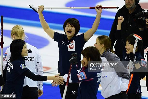 Kaho Onodera of Japan and team mates Yumie Funayama Michiko Tomabechi and Ayumi Ogasawara celebrate after the Olympic Qualification Tournament...