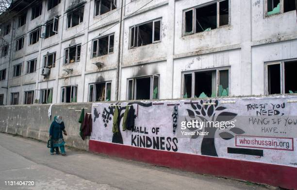 Kahsmiri Muslim women walk in front the wall of kindness on March 18 2019 in Srinagar the summer capital of Indian administered Kashmir India Kashmir...