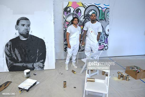 Kai and Chris Brown pose at Chris Brown And KAI At Fine Art Auctions Miami's Urban Art Week on February 12 2015 in Miami Florida