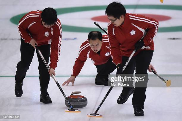 Kai Bor Liu of Chinese Taipei places a stone during the preliminary round of the men's curling against Japan on the day one of the 2017 Sapporo Asian...