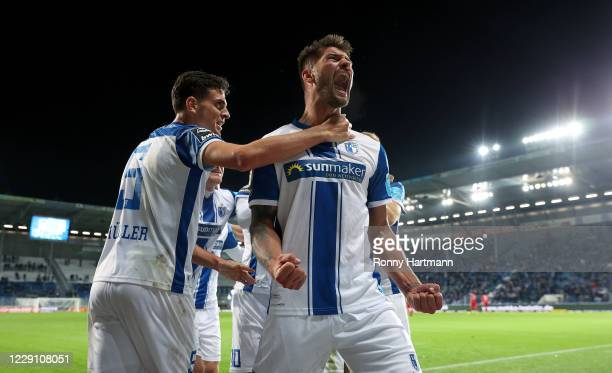 Kai Bruenker of Magdeburg celebrates after scoring his team's second goal with Tobias Mueller of Magdeburg during the 3. Liga match between 1. FC...