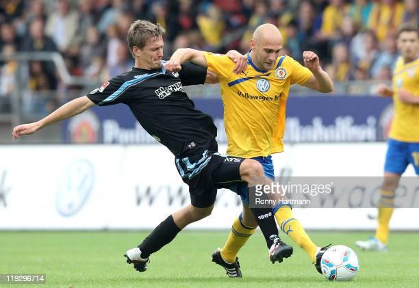 Kai Buelow of Muenchen and Damir Vrancic of Braunschweig battle for the ball during the Second Bundesliga match between Eintracht Braunschweig and...