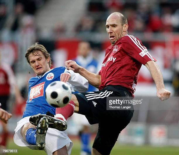 Kai Buelow of Rostock and Jan Koller of Nuremberg in action during the Bundesliga match between 1.FC Nuremberg and Hansa Rostock at the EasyCredit...