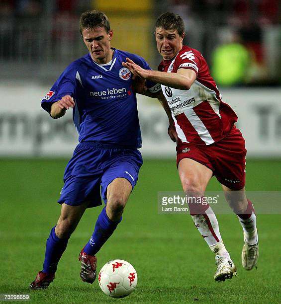Kai Buelow of Rostock in action with Gregory Vignal of Kaiserslautern during the Second Bundesliga match between 1FC Kaiserslautern and Hansa Rostock...