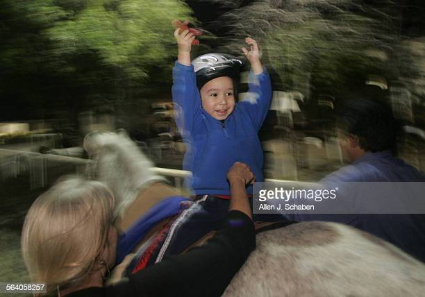 Kai Damien who was diagnosed with autism at 15 months old undergoes 'hippo therapy' horseback–riding on Baxter with physical therapist Joann Benjamin...