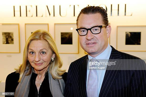 Kai Diekmann editor in chief of German daily BILD and Anja Heyne of publisher Rolf Heyne Collection pose prior to a press conference to present a new...