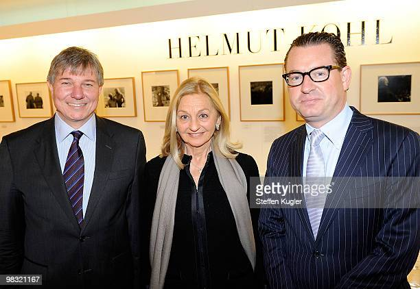 Kai Diekmann editor in chief of German daily BILD Anja Heyne of publisher Rolf Heyne Collection and photographer Daniel Biskup pose prior to a press...