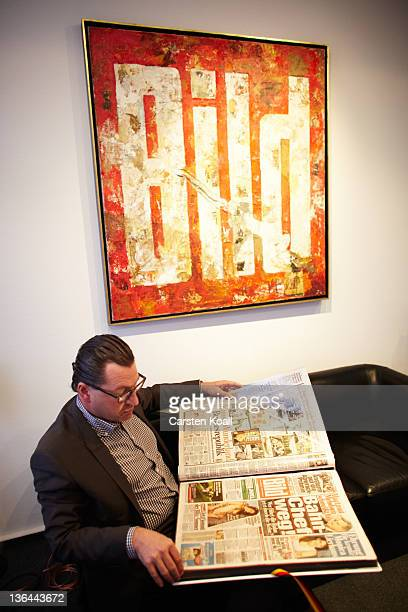 Kai Diekmann EditorinChief of the German tabloid Bild flicks through old sheets of the tabloid Bild in his office at Bild office building on December...