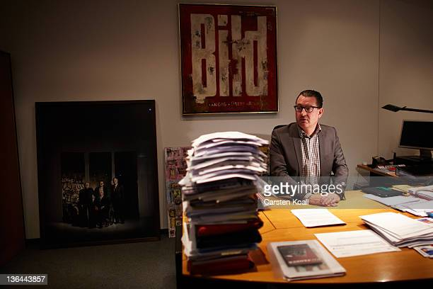 Kai Diekmann EditorinChief of the German tabloid Bild sits on his desk in his office at newspaper Bild on December 12 2010 in Berlin Germany