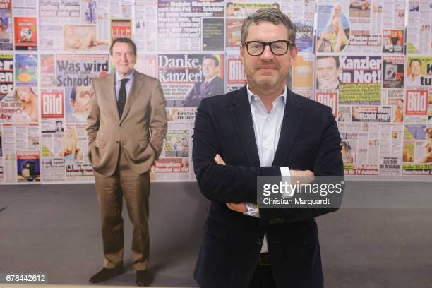 Kai Diekmann former chief editor of German Boulevard Magazin 'BILD' poses for the media during the 'FotoKunstBoulevard' exhibition preview and...