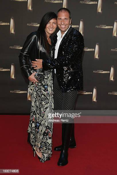 Kai Ebel and partner Mila Wiegand arrive for the German TV Award 2012 at Coloneum on October 2 2012 in Cologne Germany
