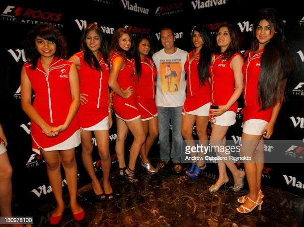 Kai Ebel German TV presenterposes with gird girls at the F1 Rocks India Afterparty on October 30 2011 in Delhi India