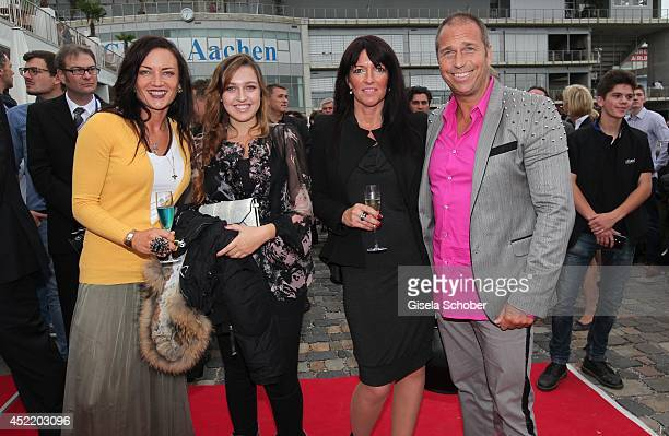 Kai Ebel with wife Mila Wiegand daughter Robin and Exwife Natascha attend the CHIO 2014 media night on July 15 2014 in Aachen Germany
