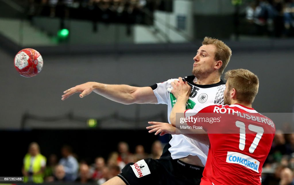 Kai Haefner #25 of Germany challenges Samuel Roethlisberger (L) of Switzerland during the 2018 EHF European Championship Qualifier between Germany and Switzerland at OVB-Arena on June 18, 2017 in Bremen, Germany.