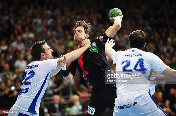 Kai Haefner of Germany is challenged by Stefan Rafn Sigurmannsson and Tandri Mar Konraosson of Iceland during the international handball friendley...