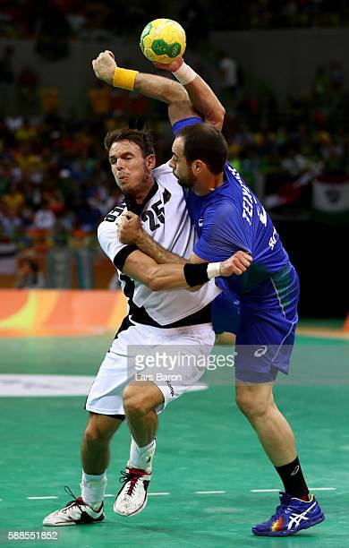 Kai Hafner of Germany is challenged by Henrique Teixeira of Brazil during the Mens Preliminary Group B match between Brazil and Germany at Future...
