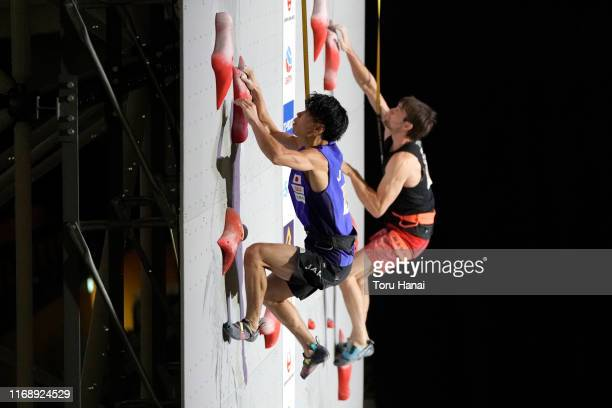 Kai Harada of Japan and Jan Hojer of Germany compete in the Speed during Combined Men's Qualification on day nine of the IFSC Climbing World...