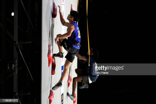 Kai Harada of Japan and Mickael Mawem of France compete in the Speed during Combined Men's Final on day eleven of the IFSC Climbing World...