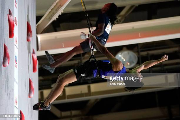 Kai Harada of Japan reacts as he competes with Mickael Mawem of France in the Speed during Combined Men's Final on day eleven of the IFSC Climbing...