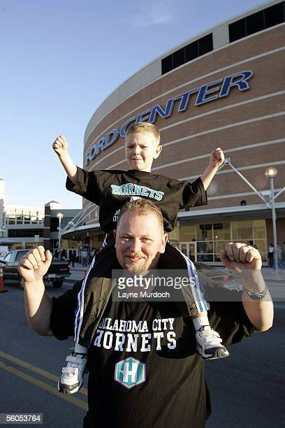 Kai Harwood and his son Darren Harwood 4yearsold from Norman Oklahoma cheer on the New Orleans/Oklahoma City Hornets before the opening game against...
