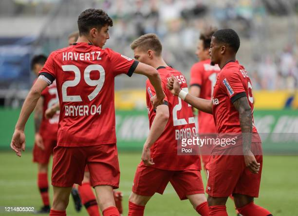 Kai Havertz and Leon Bailey of Bayer 04 Leverkusen celebrate their sides third goal during the Bundesliga match between Borussia Moenchengladbach and...