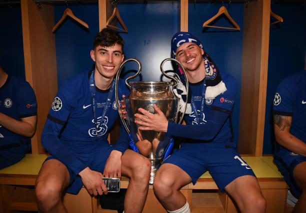 Kai Havertz and Mason Mount of Chelsea celebrate with the Champions League Trophy inside the dressing room following their team's victory during the...
