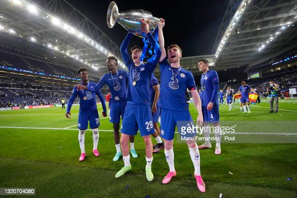 Kai Havertz and Timo Werner of Chelsea celebrate with the Champions League Trophy following their team's victory during the UEFA Champions League...