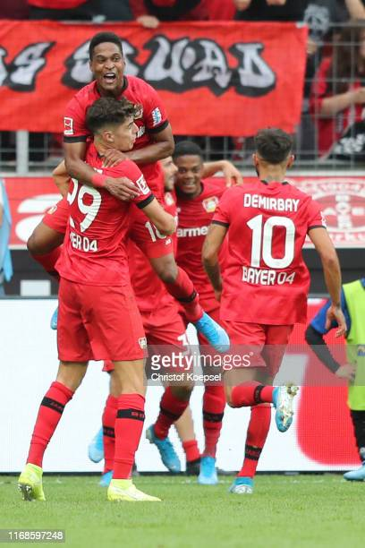 Kai Havertz and Wendell of Leverkusen celebrate the third goal of Kevin Volland during the Bundesliga match between Bayer 04 Leverkusen and SC...