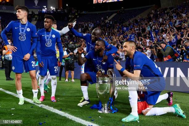 Kai Havertz, Callum Hudson-Odoi, N'Golo Kante, Antonio Rudiger and Hakim Ziyech celebrate with the UEFA Champions League Trophy after winning the...