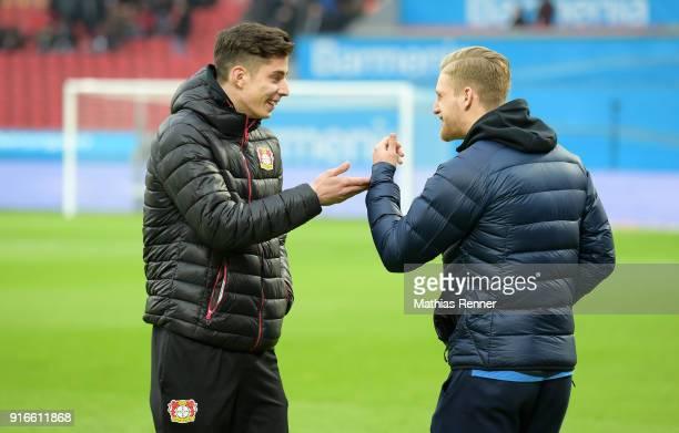 Kai Havertz of Bayer 04 Leverkusen and Arne Maier of Hertha BSC before the first Bundeliga game between Bayer 04 Leverkusen and Hertha BSC at...