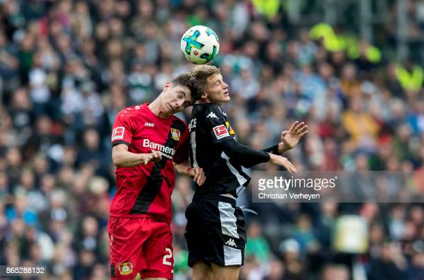 Kai Havertz of Bayer 04 Leverkusen and Michael Cuisance of Borussia Moenchengladbach battle for the ball during the Bundesliga match between Borussia...