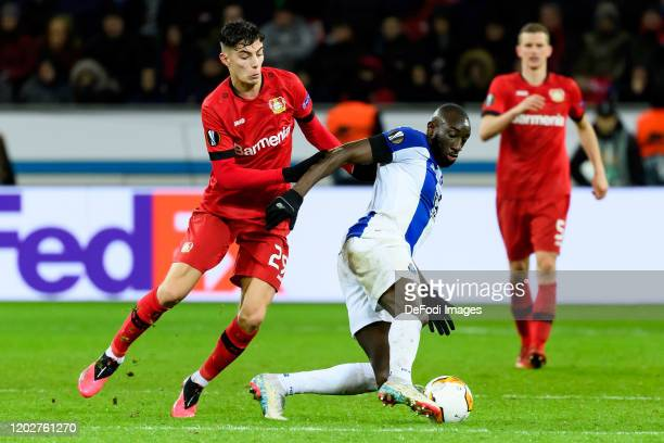 Kai Havertz of Bayer 04 Leverkusen and Moussa Marega of FC Porto battle for the ball during the UEFA Europa League round of 32 first leg match...