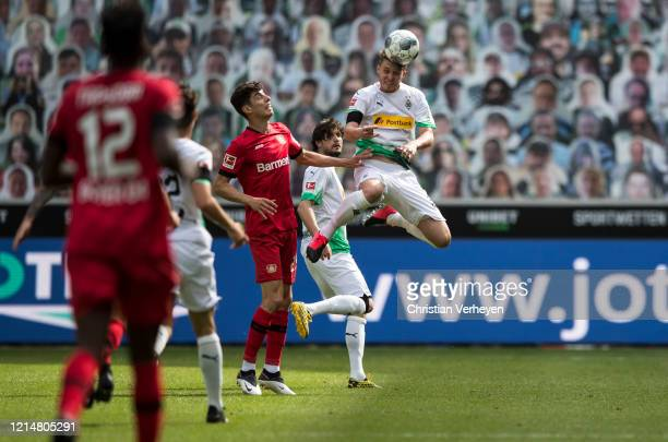Kai Havertz of Bayer 04 Leverkusen and Nico Elvedi of Borussia Moenchengladbach battle for the ball during the Bundesliga match between Borussia...