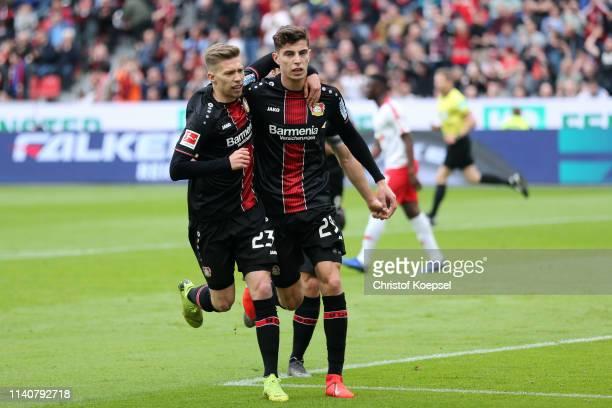 Kai Havertz of Bayer 04 Leverkusen celebrates after scoring his team's first goal with his team mates during the Bundesliga match between Bayer 04...