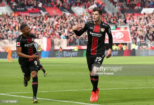 Kai Havertz of Bayer 04 Leverkusen celebrates after scoring his team's second goal with Leon Bailey of Bayer 04 Leverkusen during the Bundesliga...