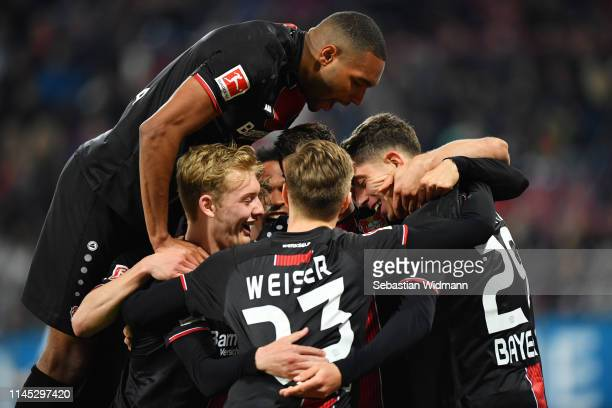 Kai Havertz of Bayer 04 Leverkusen celebrates after scoring his team's second goal with team mates during the Bundesliga match between FC Augsburg...