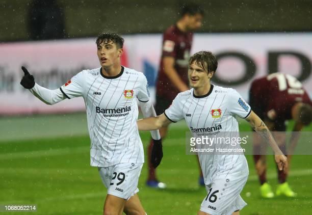 Kai Havertz of Bayer 04 Leverkusen celebrates as he scores his team's first goal with Tin Jedvaj during the Bundesliga match between 1 FC Nuernberg...