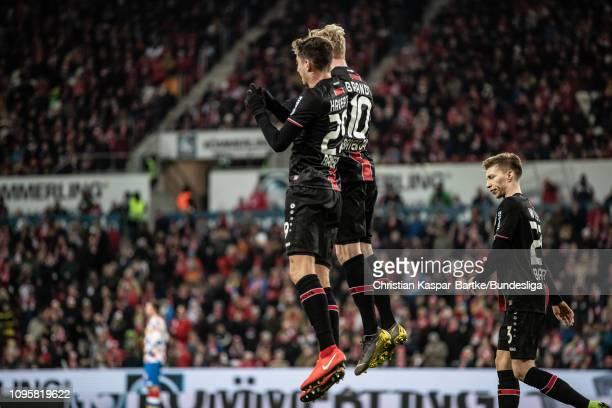 Kai Havertz of Bayer 04 Leverkusen celebrates his team`s second goal with teammate Julian Brandt of Bayer 04 Leverkusen during the Bundesliga match...