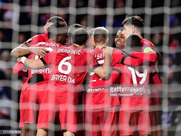 Kai Havertz of Bayer 04 Leverkusen celebrates with his team mates after scoring his team's first goal during the UEFA Europa League round of 16 first...