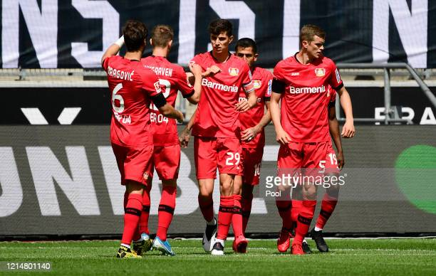 Kai Havertz of Bayer 04 Leverkusen celebrates with his team mates after scoring his team's first goal during the Bundesliga match between Borussia...