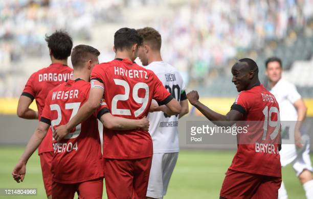 Kai Havertz of Bayer 04 Leverkusen celebrates with his team mates after scoring his team's second goal from the penalty spot during the Bundesliga...