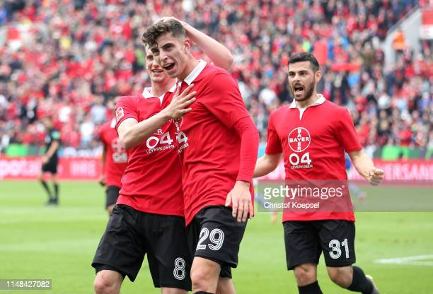 Kai Havertz of Bayer 04 Leverkusen celebrates with teammate Lars Bender after scoring his team's first goal during the Bundesliga match between Bayer...
