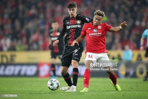 Kai Havertz of Bayer 04 Leverkusen is challenged by Kunde Malong of 1.FSV Mainz 05 during the Bundesliga match between 1. FSV Mainz 05 and Bayer 04...