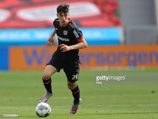 Kai Havertz of Bayer 04 Leverkusen runs with the ball during the Bundesliga match between Bayer 04 Leverkusen and 1. FSV Mainz 05 at BayArena on June...