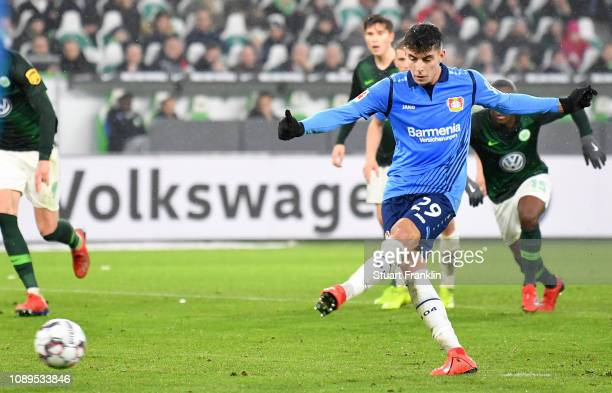 Kai Havertz of Bayer 04 Leverkusen scores a penalty for his team's first goal during the Bundesliga match between VfL Wolfsburg and Bayer 04...