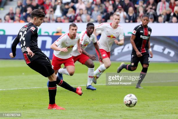Kai Havertz of Bayer 04 Leverkusen scores his team's first goal from the penalty spot during the Bundesliga match between Bayer 04 Leverkusen and RB...