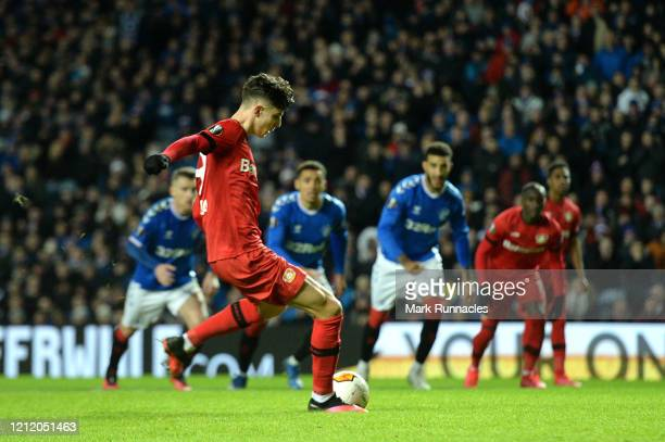 Kai Havertz of Bayer 04 Leverkusen scores his team's first goal from the penalty spot during the UEFA Europa League round of 16 first leg match...