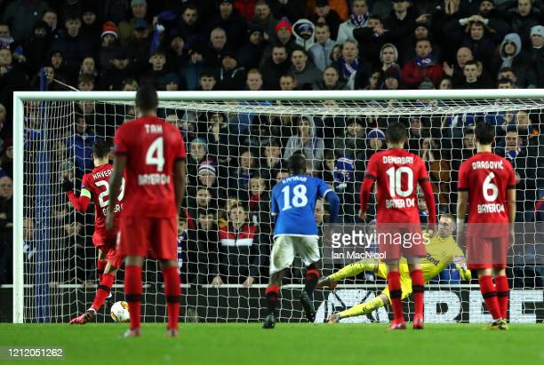 Kai Havertz of Bayer 04 Leverkusen scores his team's first goal past Allan McGregor of Rangers FC from the penalty spot during the UEFA Europa League...