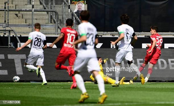 Kai Havertz of Bayer 04 Leverkusen scores his team's first goal past Yann Sommer of Borussia Moenchengladbach during the Bundesliga match between...